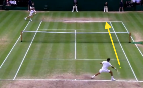 Federer takes his forehand down the line off the return