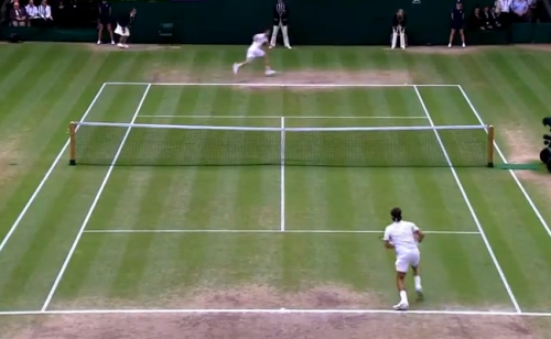 Murray chases the ball down while Federer moves forward