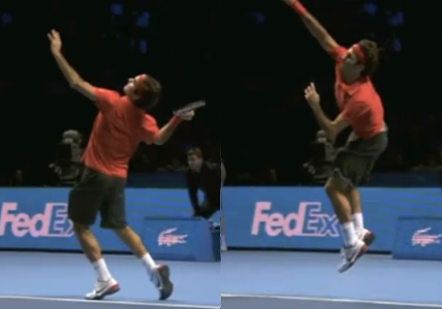 Federer jumping to hit a serve